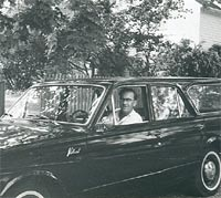Driver in his Plymouth Valiant